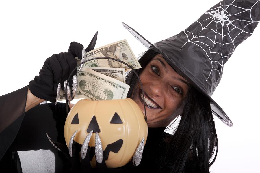 halloween witch saving money on her pumpkin